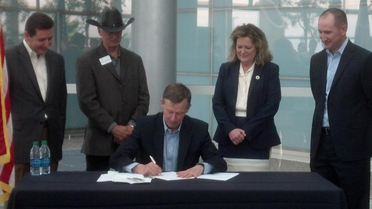 Gov. John Hickenlooper (seen here in a file photo) on Tuesday signed a tax break for space gear.