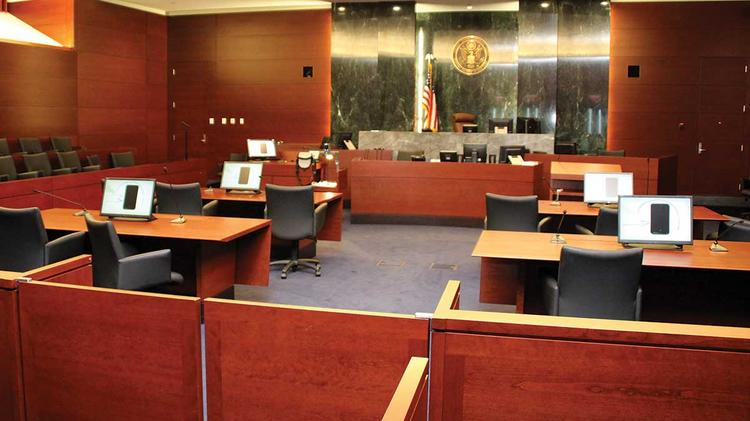 The newly-constructed U.S. District Court, a 284,000-square foot downtown facility, includes five District and four Magistrate courtrooms. Pictured here is a view of one of the courtrooms from where those in the courtroom audience sit.