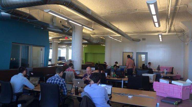 This photo posted to Twitter by MassChallenge shows the organization's new office space in the Innovation and Design Building.