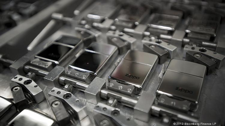 Zippo Manufacturing Co. lighters sit before being engraved at the company's plant in Bradford, Pa. The company is suing a subsidiary of Greensboro-based Lorillard for trademark infringement.
