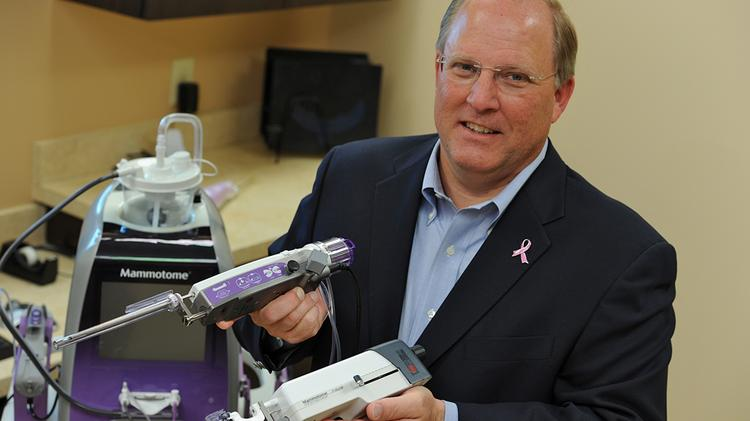 Devicor CEO Tom Daulton with some of the company's devices.