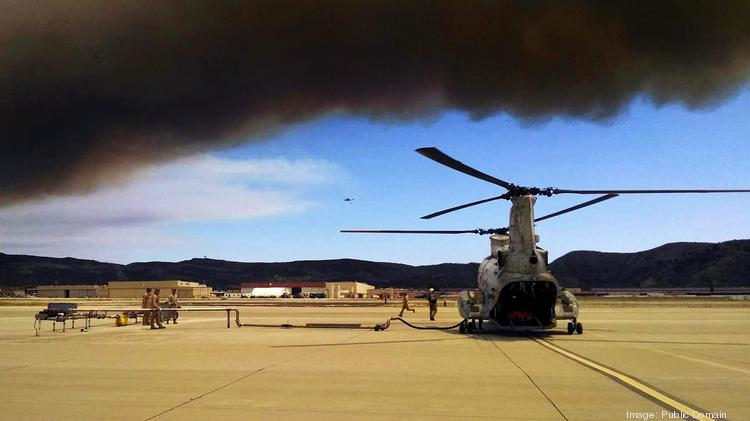 The Marines partnered with the California Department of Forestry and Fire Protection to conduct aerial firefighting against several wildfires ablaze in San Diego County using helicopters from The Boeing Co. and Sikorsky Aircraft Corp. (U.S. Marine Corps photograph by Sgt. Keonaona C. Paulo, 3rd MAW COMCAM/RELEASED)
