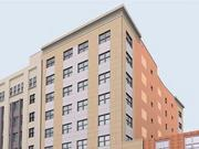 An artist rendering of the 10-story affordable housing development to be built on Oxford Street in Chinatown.