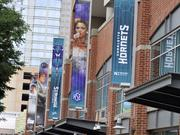 Thursday's unveiling of the court marks the final step in the Charlotte team's yearlong conversion to the Hornets nickname. Here, logos and banners can be seen hanging on the exterior of Time Warner Cable Arena.