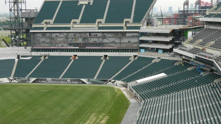 View of work on the new end zone video board and new seats being installed in the northeast corner of the Lincoln Financial Field.