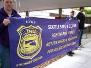 Protesters from Security Industry Specialists, the security service that Amazon uses for its Seattle facilities, gather outside the Amazon annual shareholders' meeting in Seattle on May 21, 2014. They want good, full-time and secure jobs and the freedom to form a union.