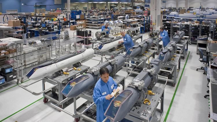 These workers are assembling what's known as the Sniper Advanced Targeting Pod, or Sniper ATP.