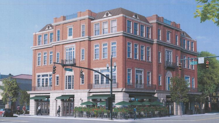 A four-story retail and condominium complex called the Gramercy is being proposed on the site of the Cup o' Joe cafe at East Main Street and Cassady Avenue.
