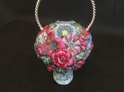 A jeweled handbag in the shape of a flower basket will be auctioned Thursday as part of the Mastro estate.