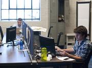 Mike Wurst, left to right, with Josh Nickols and Jonathan Whitfield, all of InvisionHeart, working at the Nashville Entrepreneur Center.