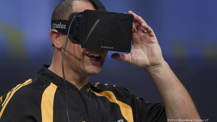 Steve Guggenheimer, vice president and chief evangelist of the Developer and Platform Evangelism Division at Microsoft Corp., wears a virtual reality (VR) headset, manufactured by Oculus VR Inc., while speaking during a keynote session at the Microsoft Developers Build Conference in San Francisco, California in April. Rockville-based ZeniMax Media is suing Oculus VR.
