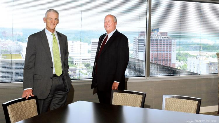 Robinson Bradshaw & Hinson offers the best 401(k) plan in the region, according to an analysis by BrightScope Inc. Shown are Managing Partner Robert Griffin (left ) and Richard Gibson Jr. , the law firm's employee-benefits administrator.