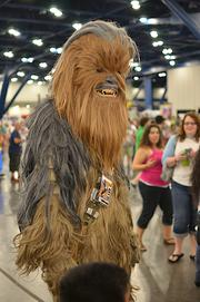 "Cosplayer (""costume player"") portraying Chewbacca, pictured at a past Comicpalooza"