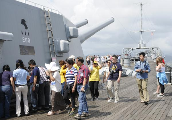 A Mandarin-speaking guide leads a group of Chinese visitors on a tour of the USS Missouri this week.