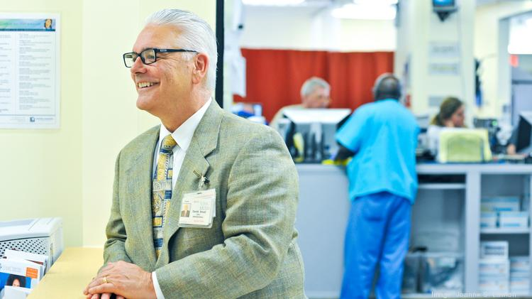 """""""I'm not saying we're out of the woods,"""" but there's progress, said United Medical Center Interim CEO David Small, standing at a new ER concierge window that helps navigate patients to primary care doctors."""