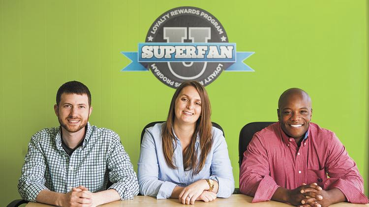 From left: SuperFanU co-founders Chris Nowak and Kayla Mount, and CEO Tendai Charasika are shown in the company's former office on Baxter Avenue. The company recently moved to The Green Building in Nulu.