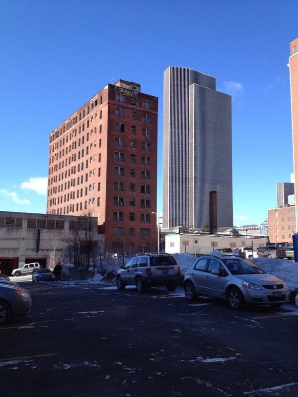 The old Wellington Hotel annex in downtown Albany, foreground, could be demolished with explosives. The Corning Tower at the Empire State Plaza is in the rear
