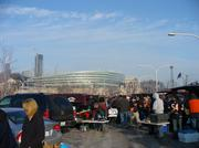 Chicago Bears fans tailgate in a parking lot that will be displaced by the George Lucas museum.