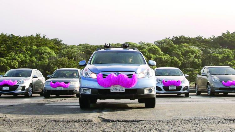Lyft drivers are marked by a pink mustache on cars. The transportation networking company plans to expand operations to Austin this week, but it's unclear how the company will fit into the city's existing for-hire transportation regulatory framework.
