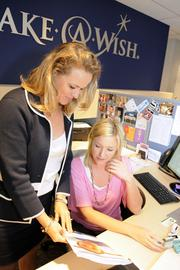 Siana Hunt, left, and Leah Vanek, special events coordinator of Make a Wish Foundation, discusses wish coordination with other chapters. was named Businesswoman of the Year for nonprofits during Pacific Business News' Women Who Mean Business awards event Thursday.
