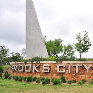 Brooks Development Authority's new president and CEO Leo Gomez envisions a strategy for Brooks City-Base that benefits a larger South Side area.