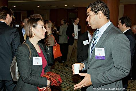 Miwa Watkins and Nicholas Colander from Consumer United talk at the social hour preceding the BBJ Pacesetters 2013 Select 70 awards. Consumer United was one of the honorees.