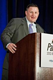 John Haley of Watermark accepts their Pacesetter award at the BBJ Pacesetters 2013 Select 70 awards breakfast.