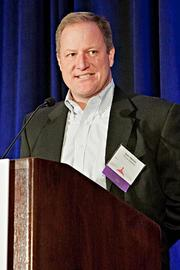 Sean Harmon of TriCore Solutions accepts their Pacesetter award at the BBJ Pacesetters 2013 Select 70 awards breakfast.