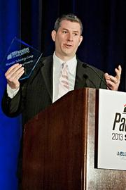 Scott Dinneen of Alezander Technology Group accepts their Pacesetter award at the BBJ Pacesetters 2013 Select 70 awards breakfast.