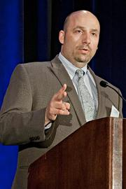 Scott Ragusa of Winter Wyman accepts their Pacesetter award at the BBJ Pacesetters 2013 Select 70 awards breakfast.