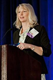 Amanda Wilson of Qvidian accepts their Pacesetter award at the BBJ Pacesetters 2013 Select 70 awards breakfast.