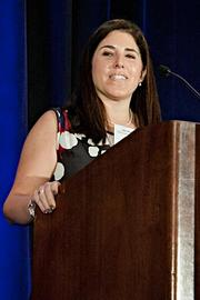 Jennifer Lourie of State Cleaning Services accepts their Pacesetter award at the BBJ Pacesetters 2013 Select 70 awards breakfast.