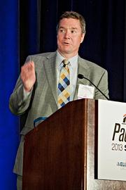 Timothy Barrett of Barrett Distribution Centers accepts their Pacesetter award at the BBJ Pacesetters 2013 Select 70 awards breakfast.