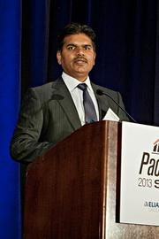 Dr. Raj Dharampuriya of eClinicWorks accepts their Pacesetter award at the BBJ Pacesetters 2013 Select 70 awards breakfast.