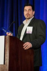 Mike Cook of Corporate [IT] Solutions accepts their Pacesetter award at the BBJ Pacesetters 2013 Select 70 awards breakfast.