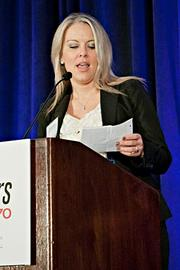 Christie Bellany of Big Night Entertainment Group  accepts their Pacesetter award at the BBJ Pacesetters 2013 Select 70 awards breakfast.