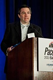 Chris Gervais of Enservio  accepts their Pacesetter award at the BBJ Pacesetters 2013 Select 70 awards breakfast.