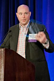 Matt Murray of EdgeRock Technology Partners  accepts their Pacesetter award at the BBJ Pacesetters 2013 Select 70 awards breakfast.