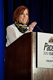 Meg O'Leary of Inkhouse  accepts their Pacesetter award at the BBJ Pacesetters 2013 Select 70 awards breakfast.