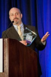 Paul Mancini of Trinity Building & Construction Management  accepts their Pacesetter award at the BBJ Pacesetters 2013 Select 70 awards breakfast.