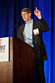 Randy Saville of Stategic Workspaces accepts their Pacesetter award at the BBJ Pacesetters 2013 Select 70 awards breakfast.