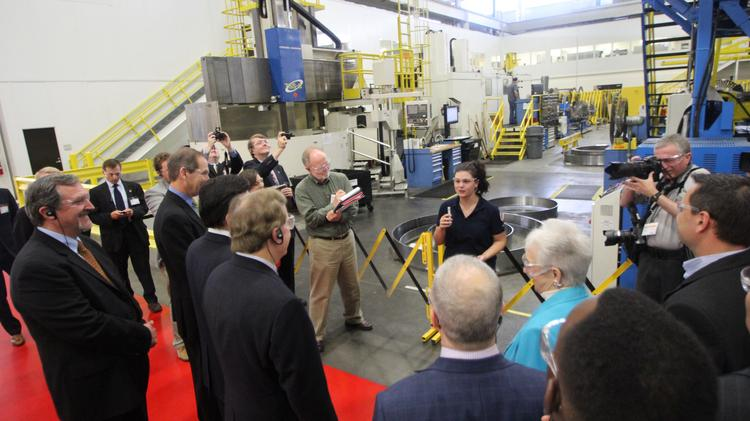 Hope Johnson, 19, talks to members of Congress at the Siemens plant in Charlotte this morning.