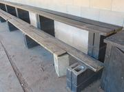 The dugouts at Henry Aaron Field include benches supported by cinder blocks.