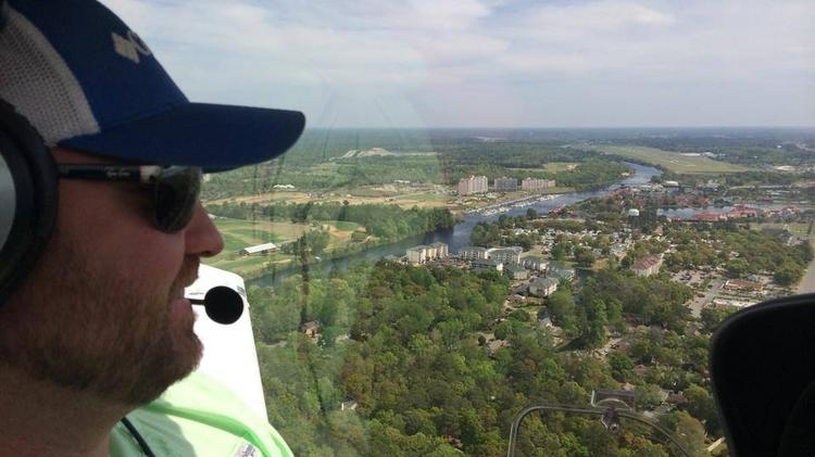"""Charles """"Trey"""" Walters, president and flight instructor at Blue Line Aviation LLC enjoys the view from an aircraft."""