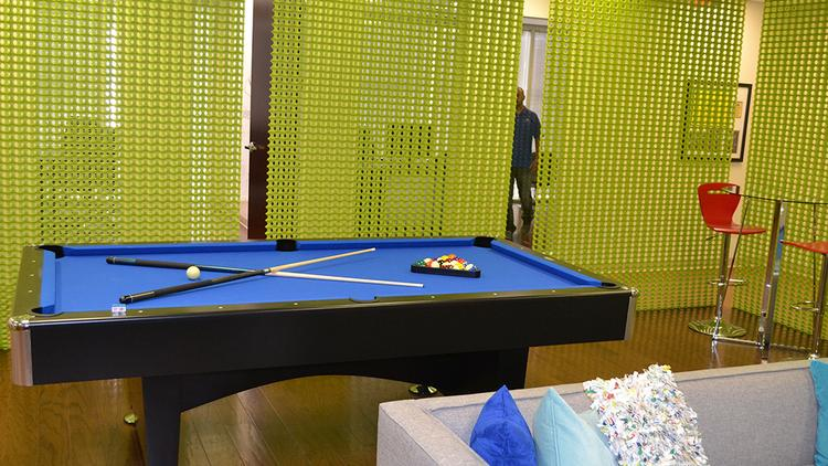 Lots of the 2014 Coolest Office Space nominees have billiard tables. Deliver Media has its felted in the company's blue.