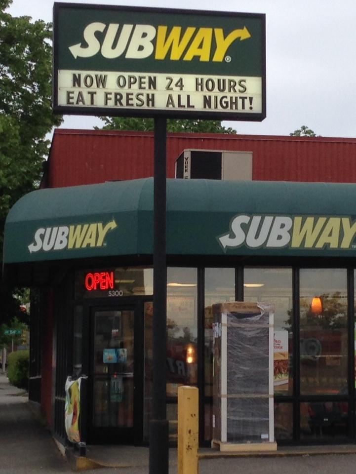 Matthew Hollek owns this Subway on 15th Avenue in Seattle's Ballard neighborhood. Because Subway shop owners are part of a franchise, his store is defined as a large business under Seattle's proposed minimum-wage law. He and many other owners of franchise outlets say they should be treated as small business. When Hollek's refrigerated drink display broke (outside the window), he said he had to replace it without financial help from the chain.