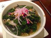 Veggie ramen -- one of four varieties of ramen -- highlighted by kale and onion