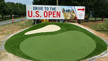 The N.C. Departments of Commerce, Cultural Resources and Transportation have installed these signs at the Raleigh-Durham International Airport to welcome visitors to the upcoming U.S. Open and U.S. Open Women's Championships.