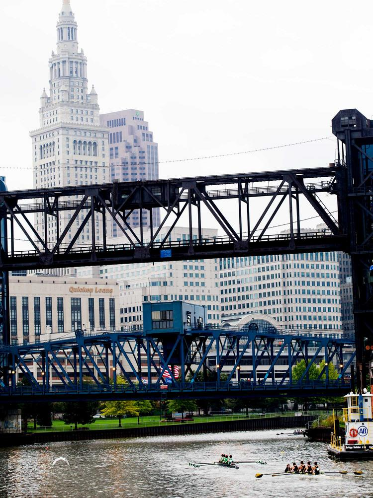 The Cuyahoga River has made great strides since famously catching fire decades ago, and now hosts crew teams and other recreation.