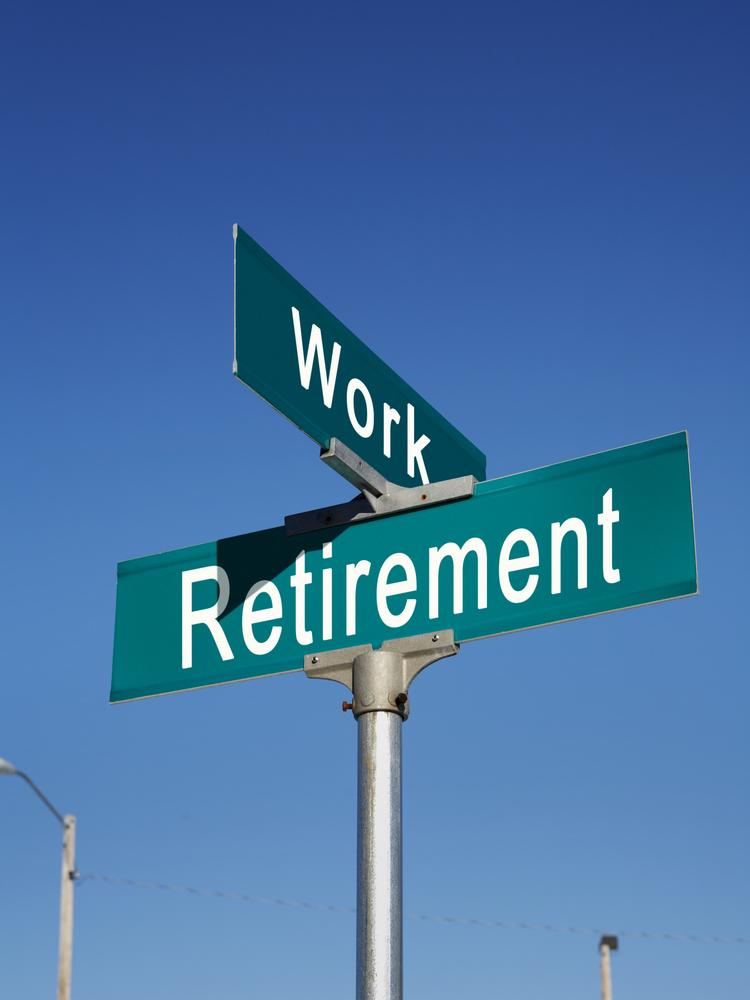 Retirement and work crossroads sign